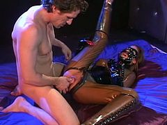 Dirty BDSM scene along hottie in latex costume while engulfing cock in each of her tight holes