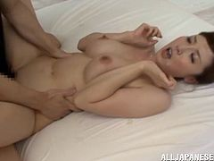 Sizzling hot oriental babe gets her boobs licked and rides erected dick in a reverse cowgirl pose. Then she gets her soaking snatch drilled doggystyle and mish until dude cums on her face.