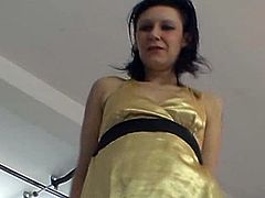 This Czech milf is wearing a golden babydoll while lap dancing. She rubs her pussy over the casting manager's crotch and she also strokes his cock a little.