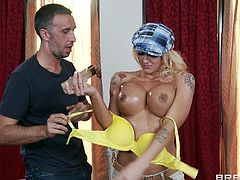 Leya Falcon is having fun with Keiran Lee indoors. Leya lets Keiran oil her big fake tits, then she gives a blowjob to the dude and they have terrific doggy style sex.
