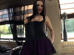 Raven haired emo chick in black fishnets pleases her asshole with dildo
