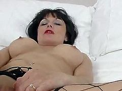 Barbie Stroker is a brunette milf with big and nicely-shaped boobs. She takes a big, pink vibrator, spreads her legs and pushes it in. She cums after stroking her rosebud.