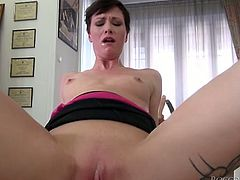 Small titted MILF with perky tits is riding hard dick in cowgirl position