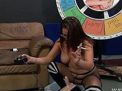 Busty brunette slut enjoys riding sex machine. her juicy tits bounce and she moans with pleasure. Then she kneels down and blows big cock like cum thirsty.
