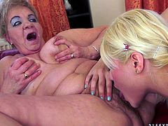 Get a load of this hot lesbian scene where this sexy blonde and a horny granny have fun pleasing one another in front of the camera.