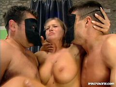 Alluring long-haired blonde is trying her best to satisfy a few men. She drives them crazy with a perfect blowjob, then gets her pussy and asshole fucked at the same time.