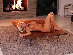 Check this blonde pornstar, with a nice ass wearing black nylon stockings, while she touches herself sensually in a solo model video.