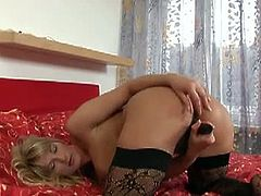 Kinky and slutty blonde haired mature bitch with awesome body and nice ass takes off her sexy lingerie and puts her fingers in her pussy. Watch how this mature babe fucks her hairy pussy with her new toy.