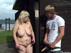 Granny Bet brings you a hell of a free porn video where you can see how this busty blonde mature gets banged by a young stud into a breathtakingly intense orgasm by the beach.