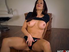 Stacy Silver is a milf from Europe with a super hot body. She manages to get off with a small vibrator called HotGVibe. She puts it on her fingers and rubs herself.