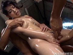 Have a blast watching this Asian brunette, with a nice ass wearing a bikini, while she goes hardcore with several dudes and moans loudly.