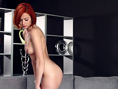 Have a good time watching this short haired redhead, with a nice ass wearing high heels, while she touches herself in an erotic way.
