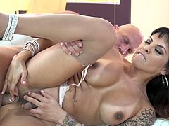 Christian XXX is having fun with beautiful shemale TS Foxxy. They have ardent oral sex and fuck doggy style and in the side-by-side position.