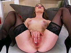 Press play to watch this brunette girl, with natural boobs wearing nylon stockings, while she touches herself ardently in her living room.