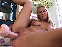 Witness this solo model video where a blonde babe, with natural jugs wearing a sexy bathing suit, while she rubs her pussy zealously.