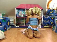 Take a look at this hot solo scene where pigtailed blonde Niki Blond shows off her sexy body as she plays with pink pussy after playing with her dolls.