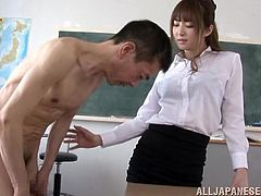 Sizzling Japanese teacher Misa Yuki, wearing a miniskirt and pantyhose, is getting naughty with her colleague indoors. She shows her nice body to the man and massages his dick with her cute feet.