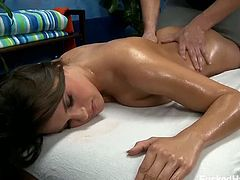 This masseur tells Teal Conrad to take off her clothes and wait for him to come back. When he returns, he massages her back and legs before fingering her pussy.