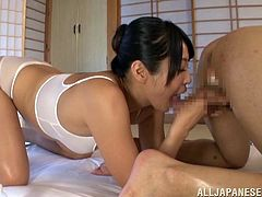 Eye catching black-haired seductress with big natural boobs knows what dude wants. She works on his erected dick with her hands and mouth until he explodes with hot cum.