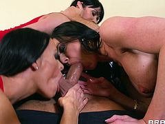 A sexy cougar with long dark hair, big beautiful tits and a fantastic body enjoys a mind-blowing gangbang in her living room.