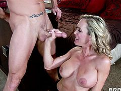 Brandi Love and her big fake tits enjoy a hardcore fuck when her husband is out. Watch her feast over this guy's dick and swallw all his jizz.