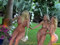 Have fun with this breath taking lesbian scene where these beautiful blonde milfs having a threesome outdoors in the patio.