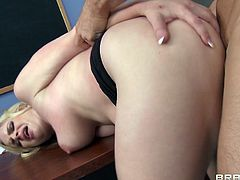A sexy young blonde with long hair, big natural tits and a great body enjoys a hardcore doggy style fuck in a classroom.