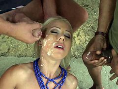 Gorgeous blonde in a miniskirt in a gang bang enjoying the thrill of massive cocks in her pussy and anal then they screw doggy style