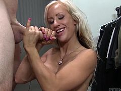 Naughty blonde with big fake tits gives her lover an amazing blowjob