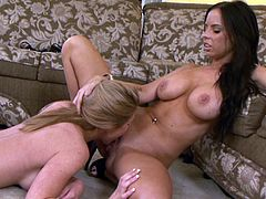 Busty bombshells Ashley Winters and Brandy Aniston are having a good time together. The hotties make out and show their pussy-eating skills to each other.