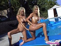 Get a load of this amazing lesbian scene where these gorgeous blondes oil themselves up and show off their bodies outdoors before soaking each other with a water hose.