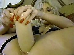 Curly busty blondie masturbates with her fancy toys