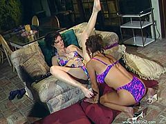 Gorgeous lesbian cougars Alex Foxe and Lori Rivers wears the sexiest bikinis as they lick and toy their delicious wet holes.