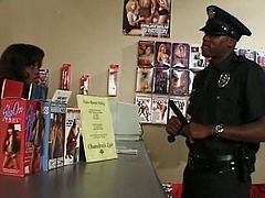 Voracious black skank sucks bartender's BBC under the bar and dirty cop notices it. He picks up that bitch and hammers her wet pussy doggystyle before getting a head.