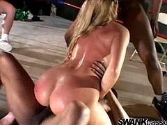 Make sure you see this! A brunette doll, with a nice ass and natural boobs, while she gets DP and sucks a huge pole at the same time.