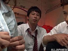 Admirable Japanese chick, wearing stockings, is getting naughty with a few men indoors. The guys rubs the hottie's twat and fuck it by turns in the missionary position.