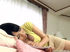 A horny Japanese mom shows her huge natural tits to a guy and lets him knead them. After that the milf shows her titjob talent to the dude.
