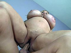 The big beautiful woman Samantha 38G gets her huge juicy boobs oiled up and takes a hard cock up her pussy before she gets a nasty cumshot.