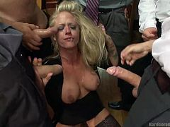 Do you like rough scenes or milfs who do not hesitate to showing off their juicy pussy and offer sexual favors? If so, watch the video to get the hottest thrills! A blonde doll is surrounded by five horny cocks who wanna humiliate her writing on her chest. The busty slut gets down on knees sucking each dick!