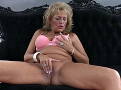 This mature blonde feels really horny and seems, like it would be a good time, to rub her pussy. She takes her jeans down, gently touching her pussy. She is getting really hot & horny with every minute, rubbing her wet vagina like crazy.
