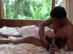 Bootyful short-haired brunette wearing black things stands on her knees in front of dude and provides him with passionate blowjob until he cums on her face.
