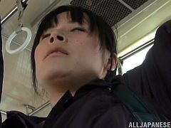 This horny Japanese babe gets really turned on by a man's bulge on the city bus and ends up sucking his big hard cock before getting drilled.