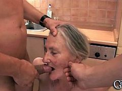 This European granny takes out her dental prosthesis and sucks on two cocks. She also reveals her huge natural boobs before she gets face-fucked some more.
