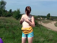 Luxurious ginger sweetie takes off her clothes exposing her big natural tits and smooth ass. Thereafter she lies on the grass and fingers her soaking snapper.
