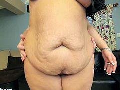 This guy stands behind Aire Fresco and plays with her jelly tummy and her huge boobs. Next she blows his cock POV style and rides it. He finishes with doggy style.