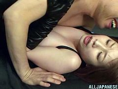 Entertain yourself by watching this Asian brunette, with natural jugs wearing leather clothes, while she gets nailed hard in a parody video.