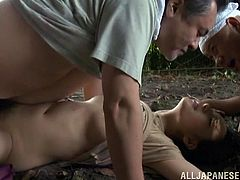 Click to watch this Asian brunette, with a nice butt wearing a cute dress, while she goes hardcore with two guys in a wild threesome.