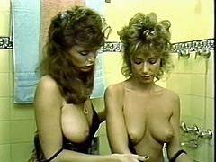 Captivating lesbians licking each other's pussies in the bathroom