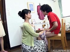 Kinky Japanese milf is playing dirty games with a man indoors. She pets the dude ardently, then takes his wang in her mouth and sucks it hungrily.