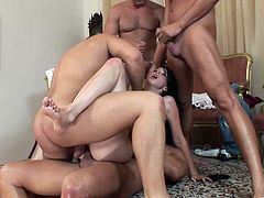 Brunette babe Betty Spark is having fun with some men indoors. She sucks their wangs ardently, then gets double penetrated a few times and drowns in cum.
